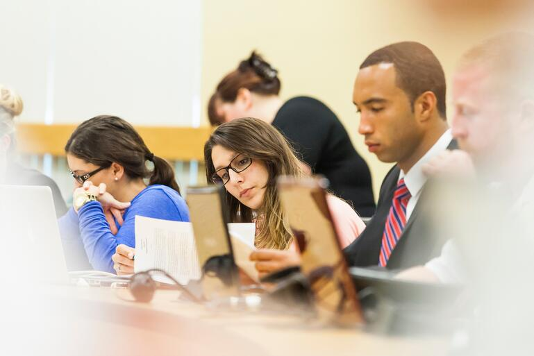 Part time law students study in class