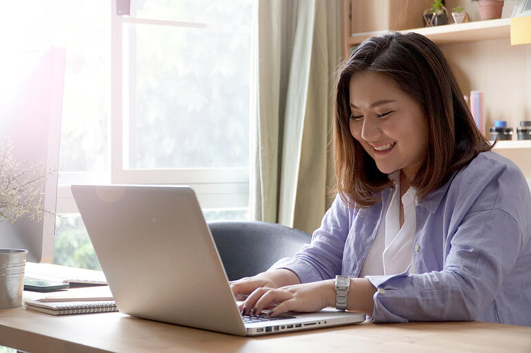Woman adding an addendum to her law school application