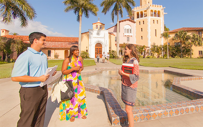 Group of diverse Stetson Law students having a conversation in the plaza.